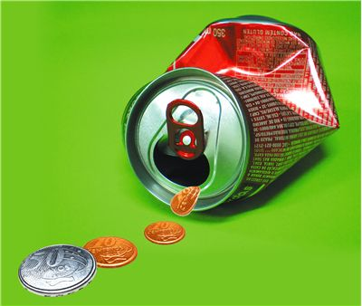 Picture Of Can Of Soft Drink And Coins
